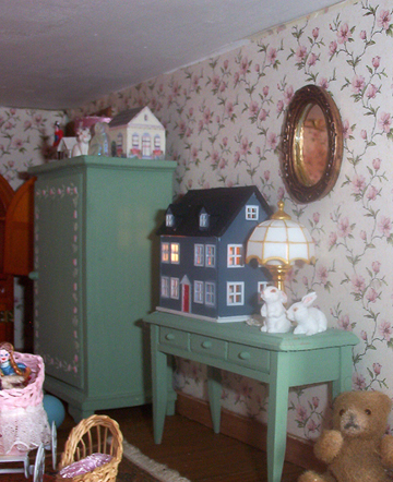 There are 3 tiny dollhouses in this room.
